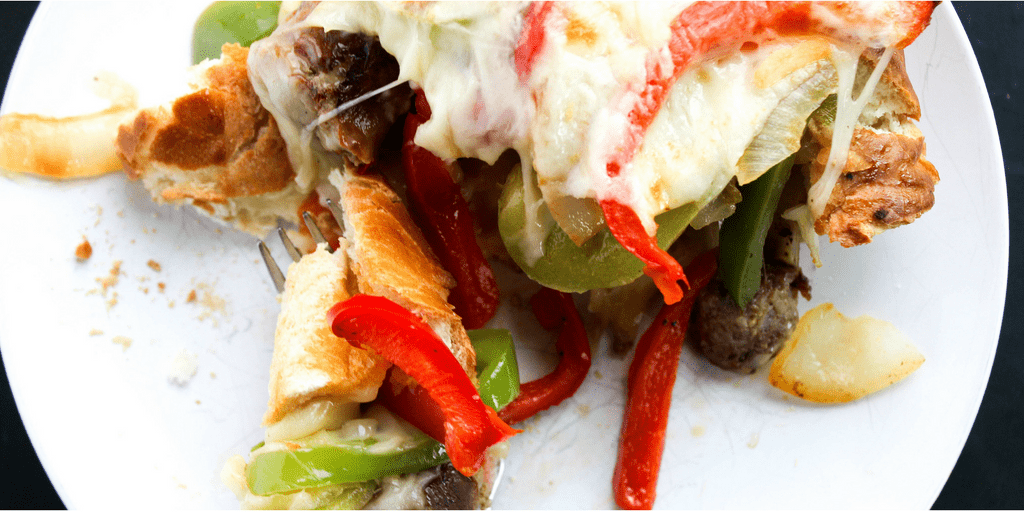 Cheesy Italian Sausage & Pepper Stuffed Bread is a twist the classic ball park sandwich, made into a fantastically easy meal.  italian-sausage-pepper-stuffed-bread