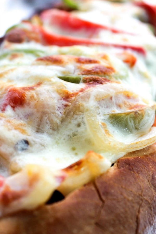 Cheesy Italian Sausage & Pepper Stuffed Bread is a twist the classic ball park sandwich, made into a fantastically easy meal.  sausage-pepper-stuffed-bread-close-up