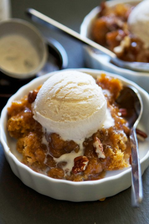 Pumpkin Pecan Cobbler with vanilla ice cream scoop