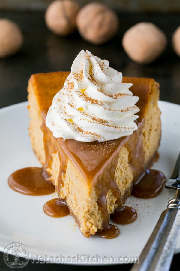 Pumpkin Cheesecake with whipped cream and caramel sauce, graham cracker crust
