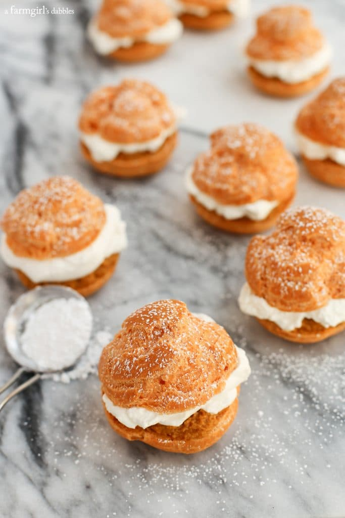 Pumpkin Pie Cream Puffs - maple whipped cream pumpkin pie filling powdered sugar
