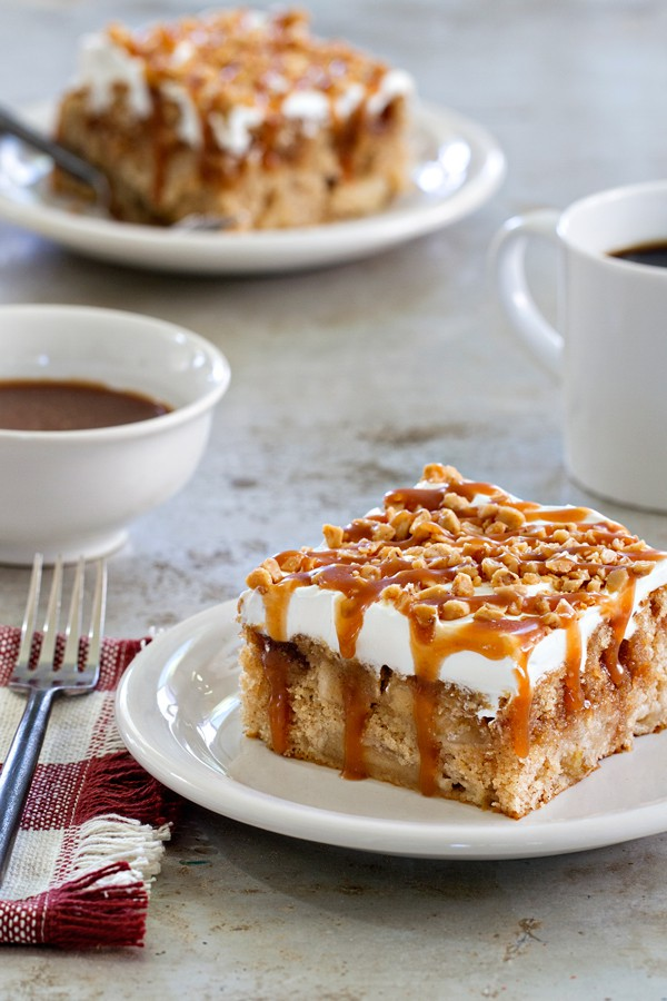 Caramel Apple Poke Cake- apple cake with whipped cream caramel drizzle and toffee bits