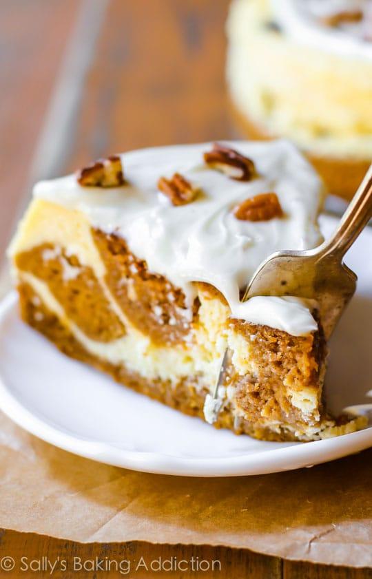 Pumpkin Cake Cheesecake swirled pie with sugar icing and pecans