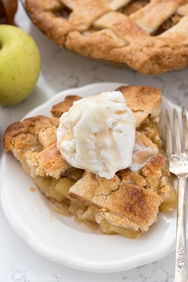 Apple Cider Pie apple pie with apple cider pie crust and dollop of vanilla ice cream