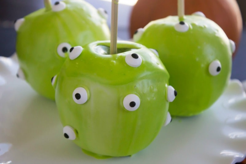 "These Quick & Easy Halloween ""Candied"" Apples are so much fun to make with the kids. They will love this festive Halloween treat!easy-quick-candied-apples-slide"