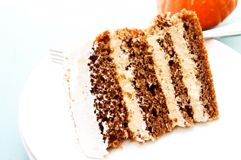 Pumpkin Spice Cheesecake Cake is a layered spice cake with a no-ba ke pumpkin cheesecake filling topped off with a dusting of pumpkin pie spice. pumpkin-spice-cheesecake-cake-piece