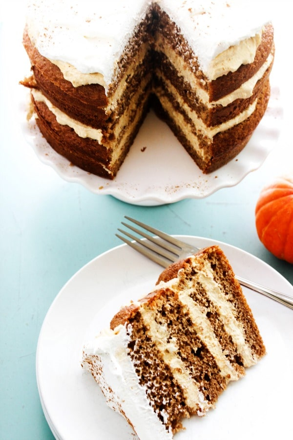 Pumpkin Spice Cheesecake Cake is a layered spice cake with a no-bake pumpkin cheesecake filling topped off with a dusting of pumpkin pie spice. pumpkin-spice-cheesecake-cake-view