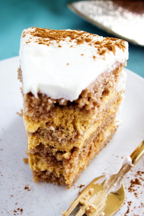 Pumpkin Spice Mousse Cake - decadent layers of pumpkin spice cake and a simple pumpkin mousse filling. A perfect fall dessert, and a Thanksgiving must have. pumpkin-spice-mousse-cake-bite