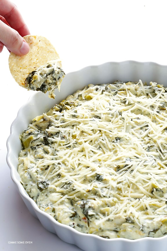 slow cooker spinach artichoke dip appetizer with chips and parmesan cheese