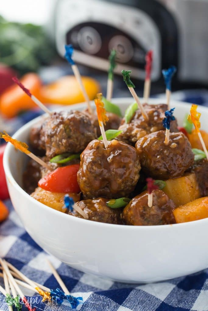 Slow Cooker Meatballs with pineapples peppers and brown sugar