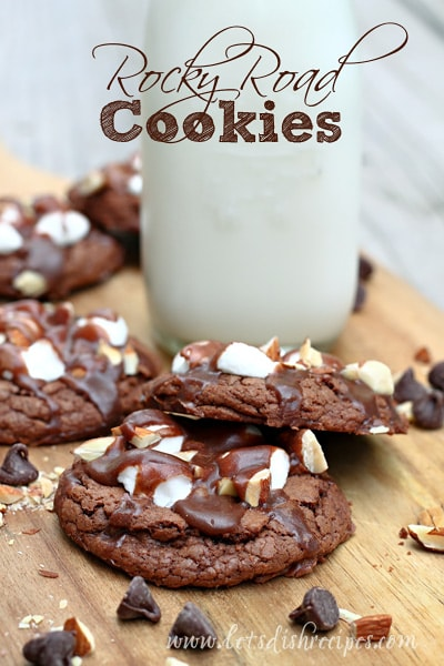 Rocky Road Chocolate cookies topped with almonds, marshmallows, and drizzled with more chocolate.
