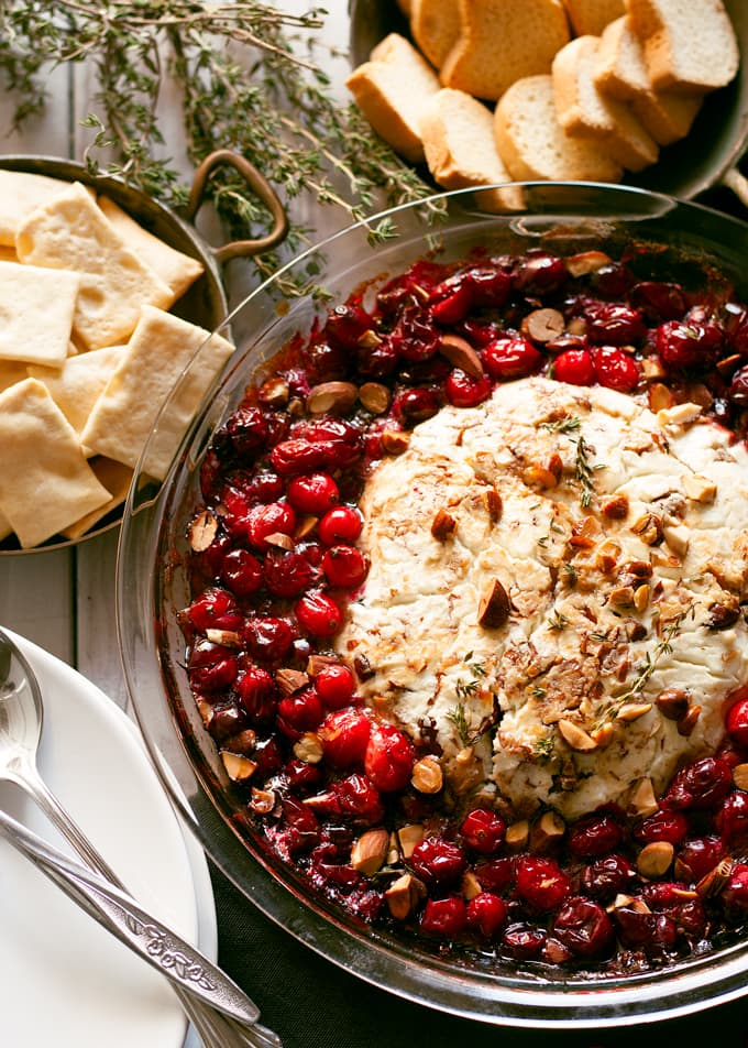 Baked Goat Cheese Roasted Cranberry Appetizer with almonds, balsamic vinegar, and thyme