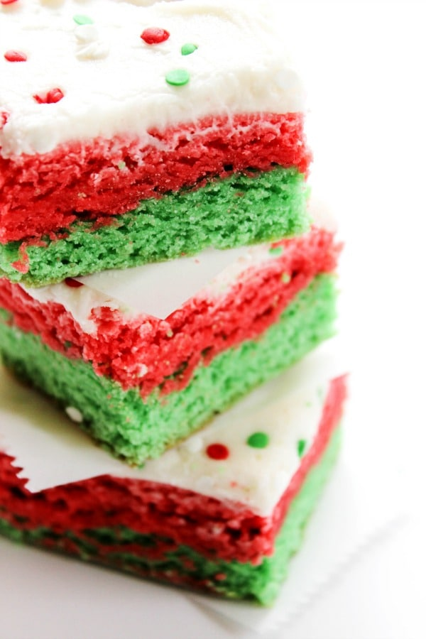 These Christmas Sugar Cookie Bars are a delicious, soft holiday treat. They are simple to make, while being both tasty and festive. christmas-sugar-cookie-bars-stack