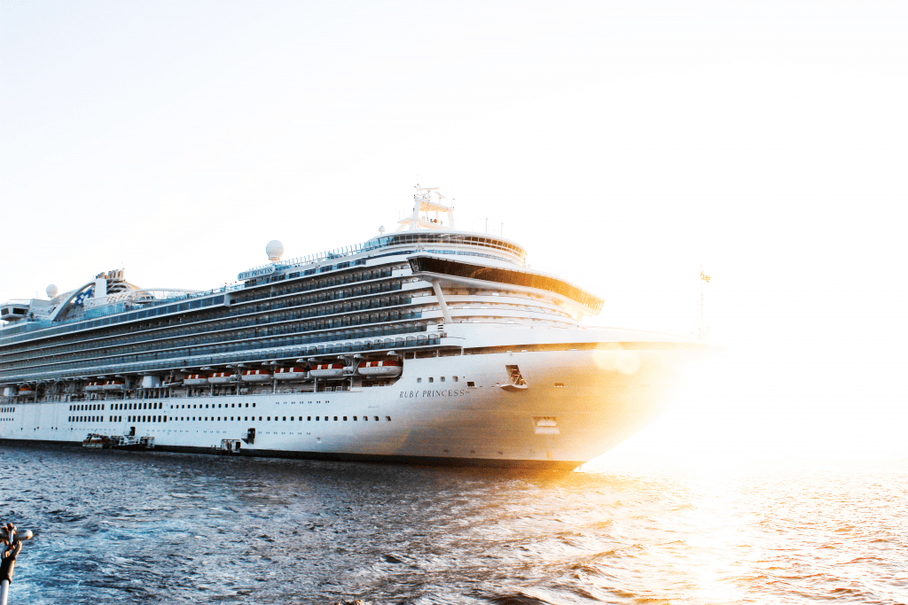 photo of the princess cruise ship in the water during sunset