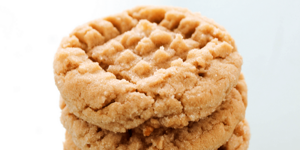 up close photo of a peanut butter cookie on top of the stack