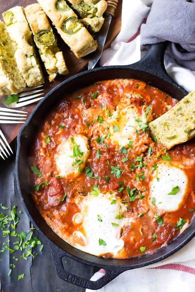 overhead photo of eggs in tomato sauce
