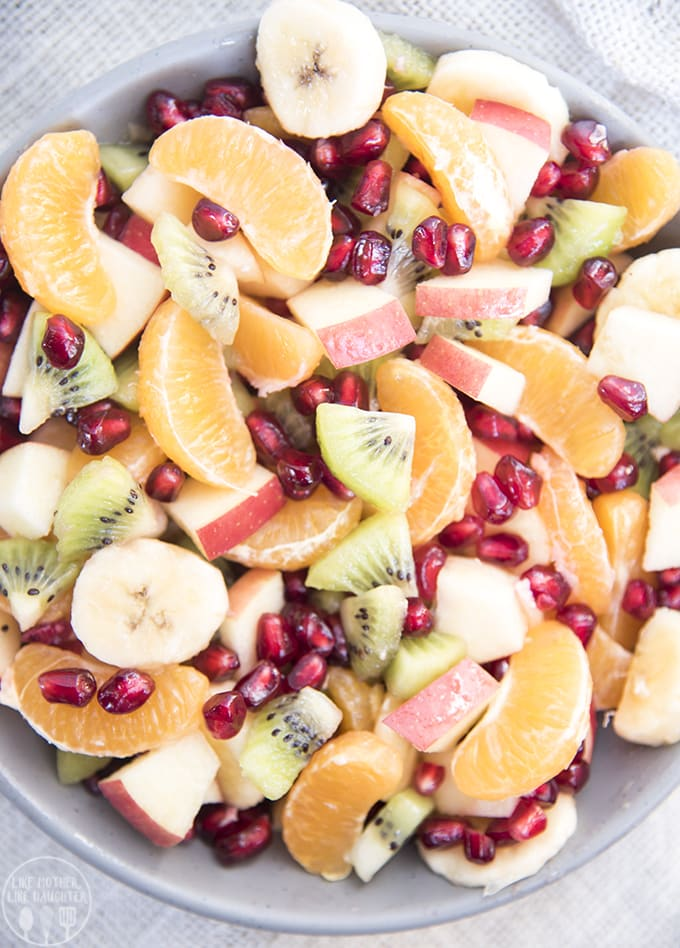 WINTER FRUIT SALAD, bananas, oranges, pomegranate seeds, kiwi, apples