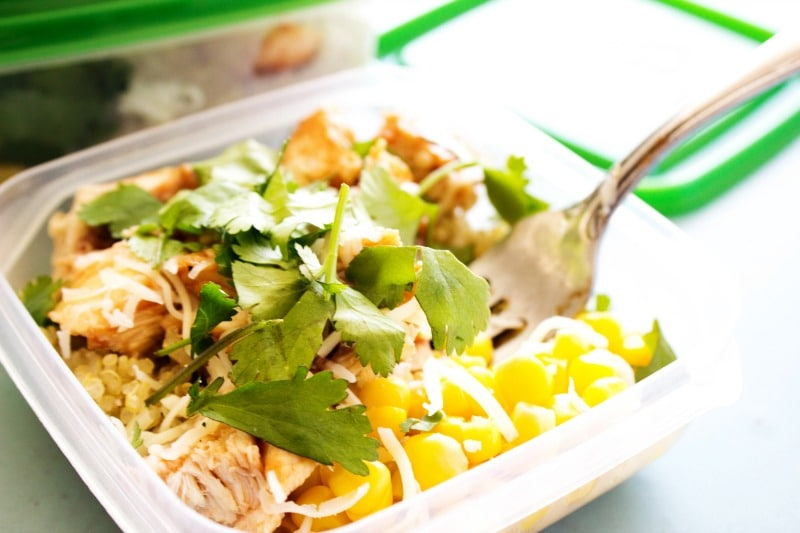 photo of  Baked Barbecue Chicken and Quinoa bowl in a tupperware container with a fork