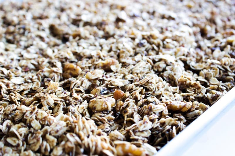 Maple Pecan Granola is a healthier granola option, great as a snack or topping on yogurt. It will quickly become a family favorite.- Metal baking sheet, white table