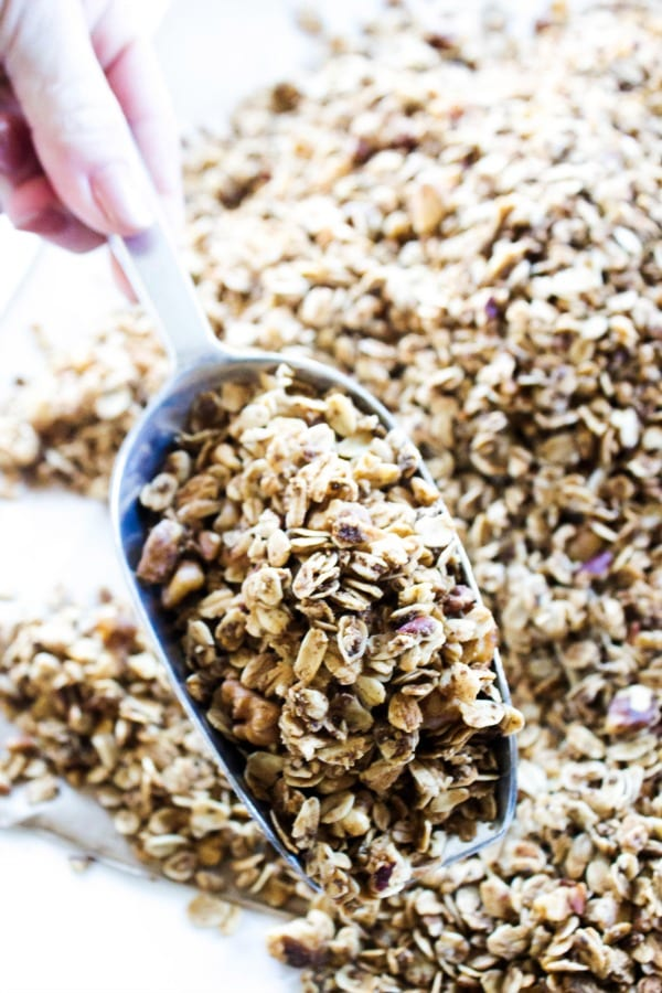 Maple Pecan Granola is a healthier granola option, great as a snack or topping on yogurt. It will quickly become a family favorite.- Metal scoop , white table