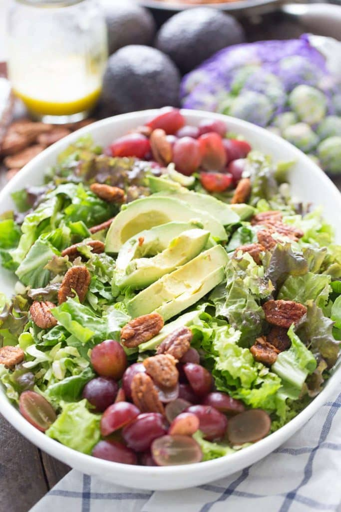 EASY HARVEST SALAD in a white bowl, salad with avocado, grapes, pecans