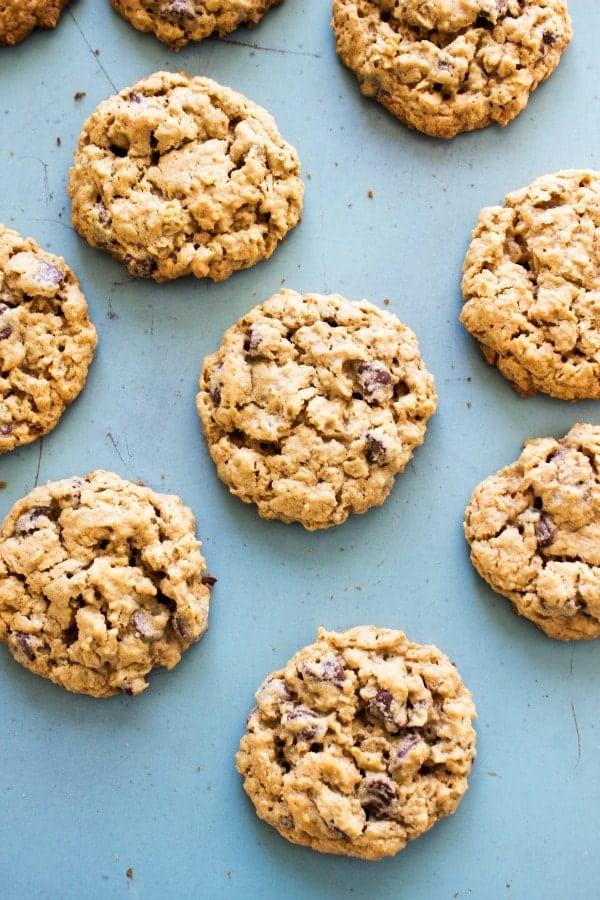 overhead photo of Chewy Oatmeal Peanut Butter Chocolate Chip Cookies on blue background