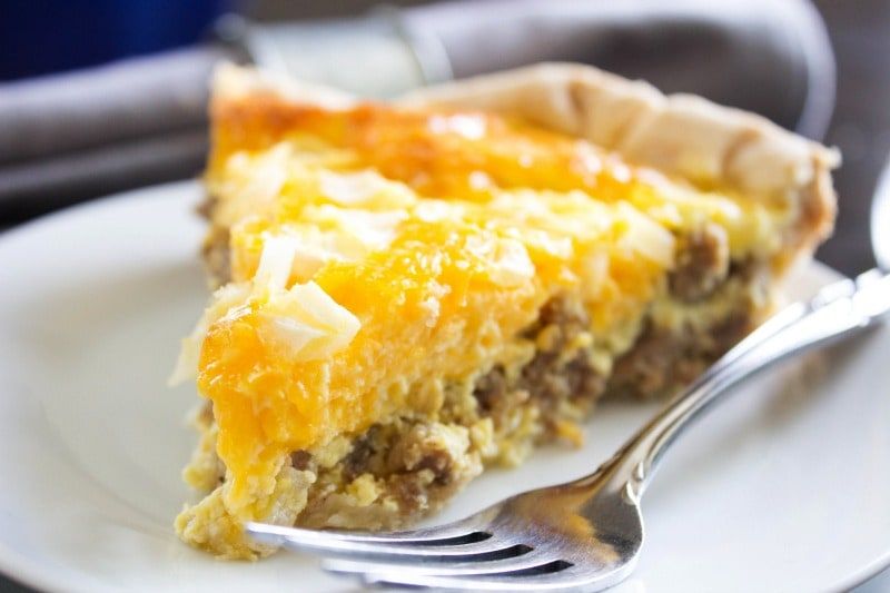 Easy Sausage Quiche slice on plate with fork