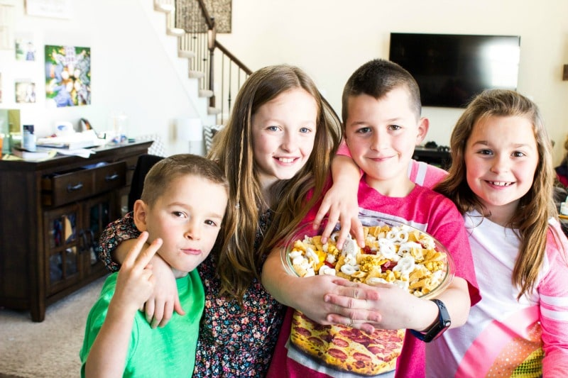 sandra's 4 younger kids, cannon, jordan, madden, and jersey, with madden holding a large glass bowl full of trail mix