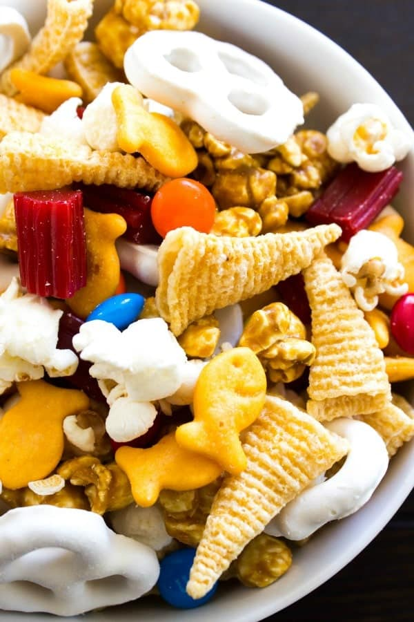 Chimney Park Trail Mix with goldfish, M&M's popcorn, yogurt covered pretzels, caramel corn, licorice and bugels in a white bowl