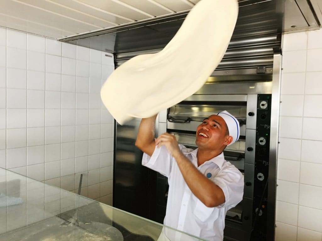 photo of chef on cruise tossing pizza dough