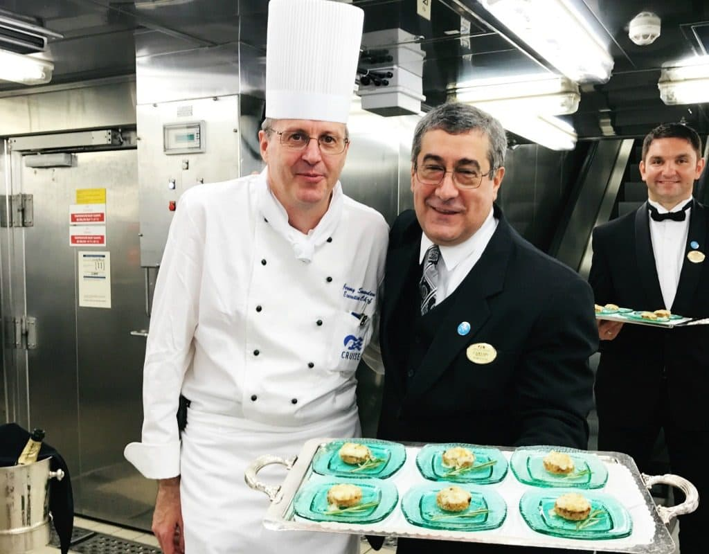 photo of the chefs on the cruise with tray of food