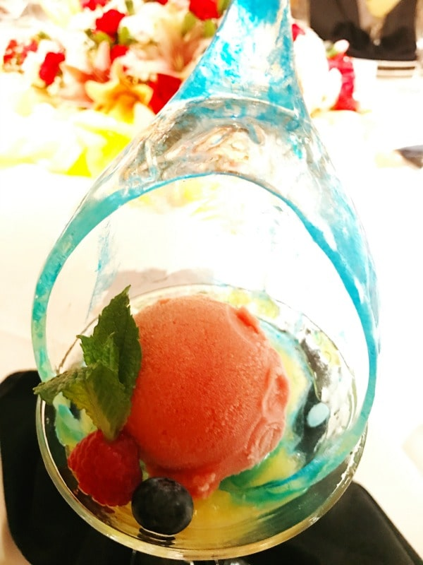 sorbet with mint leaf and berries in a glass bowl