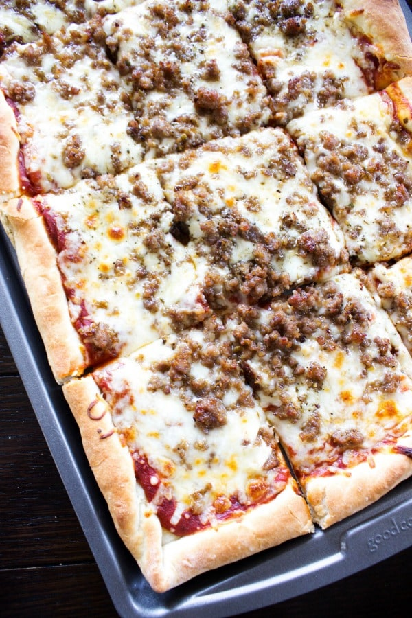 overhead view of sheet pan pizza with sausage topping
