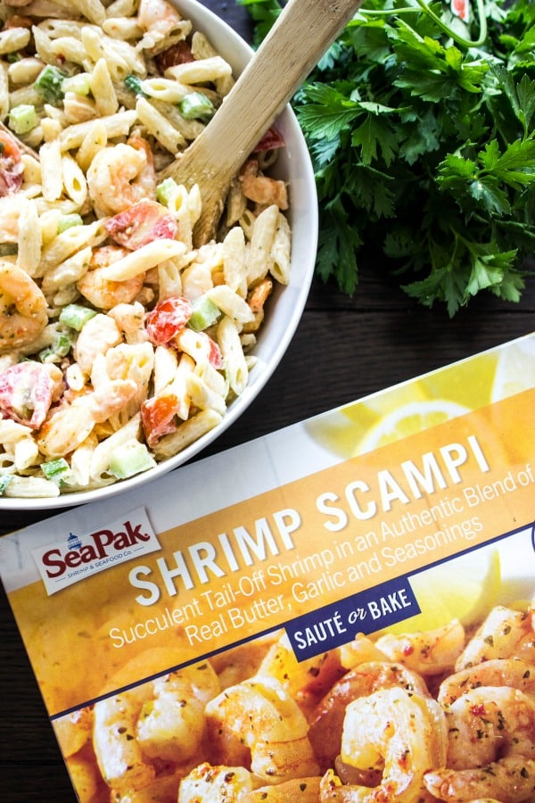 SHRIMP SCAMPI PASTA SALAD off-white bowl, wooden table, fresh herbs