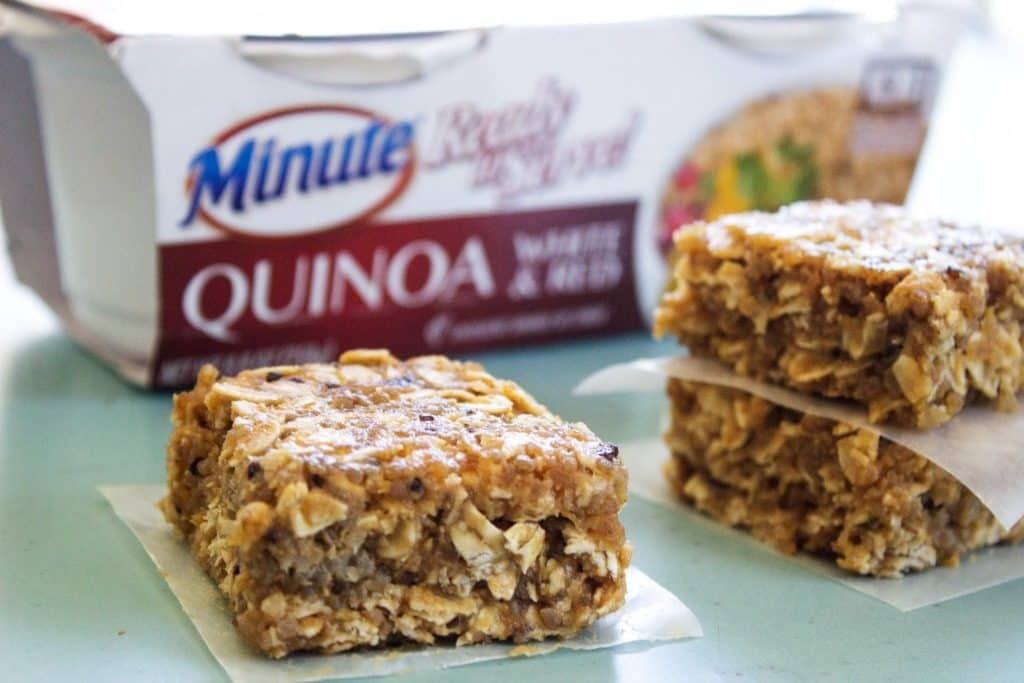 NO BAKE QUINOA & OAT BARS Minute ready quinoa, blue table, bars on parchment paper