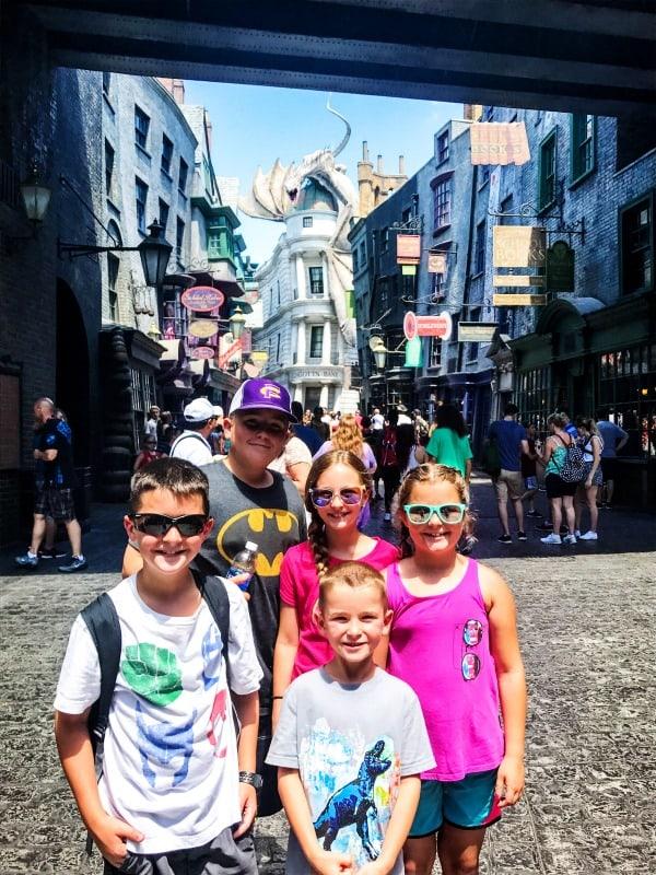 photo of sandra's 5 kids standing in hogwarts park in universal studios