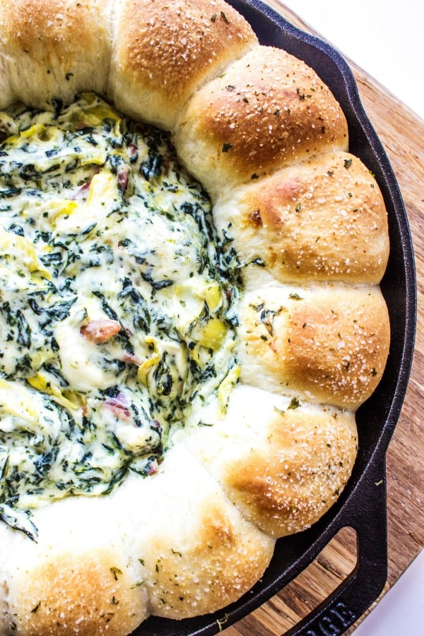 SPINACH ARTICHOKE BACON DIP RECIPE- Wooden cutting board and metal skillet