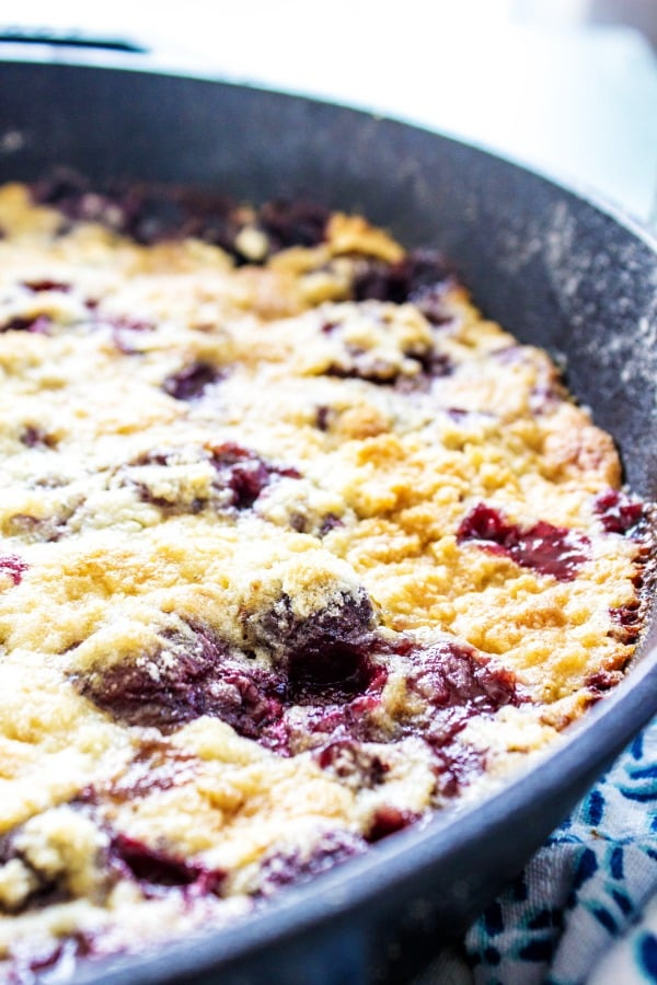 photo of baked cherry cobbler in a cast iron skillet