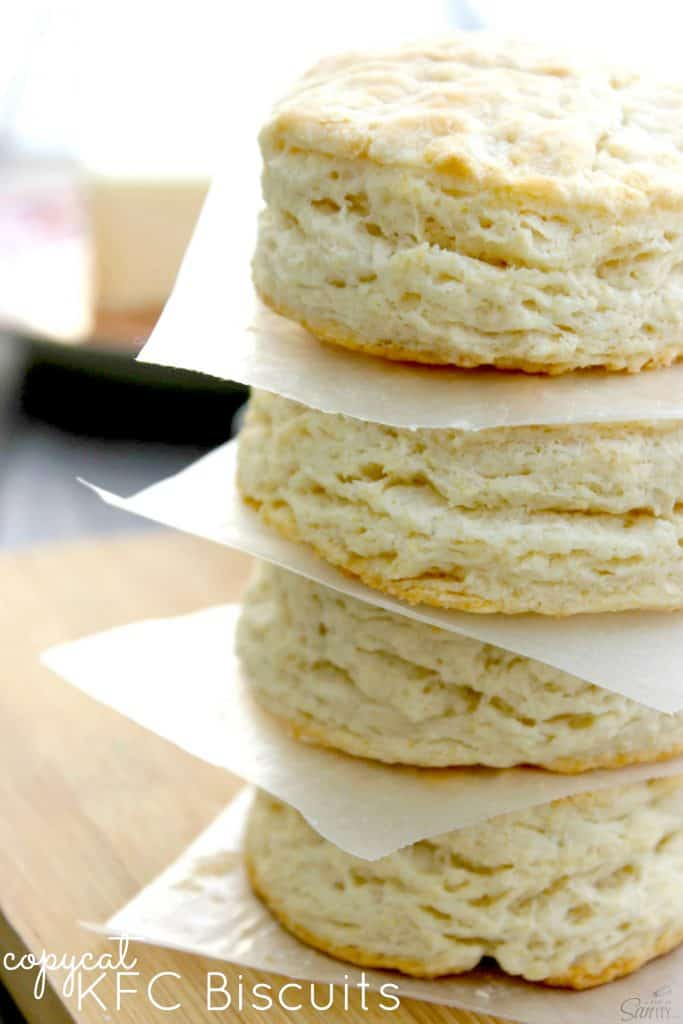 photo of a stack of 4 Copycat KFC Biscuits with parchment between each one.