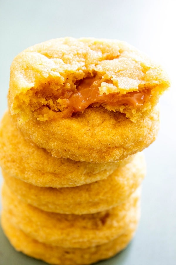 stack of 6 Pumpkin Caramel Cookies, top one has a bite taken out