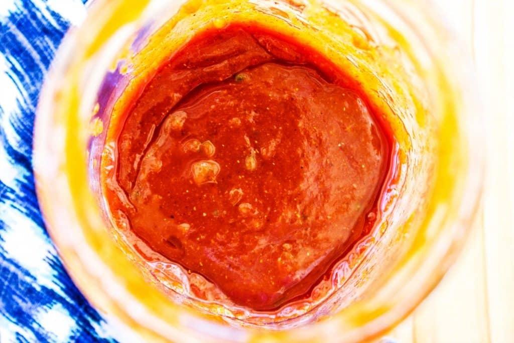 Sauce in large mason jar, blue napkin.