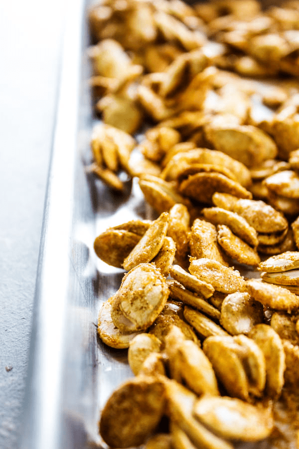 photo of CINNAMON SUGAR PUMPKIN SEEDS on a sheet pan