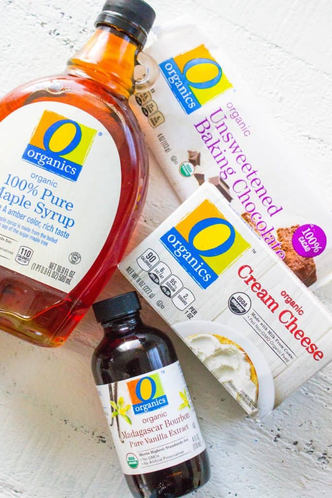 O Organics Products on counter: bottle of pure maple syrup, organic vanilla extract, box of cream cheese, unsweetened baking chocolate bare