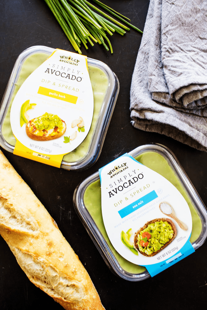 2 flavors Simply Avocado dip conatiners with baguette