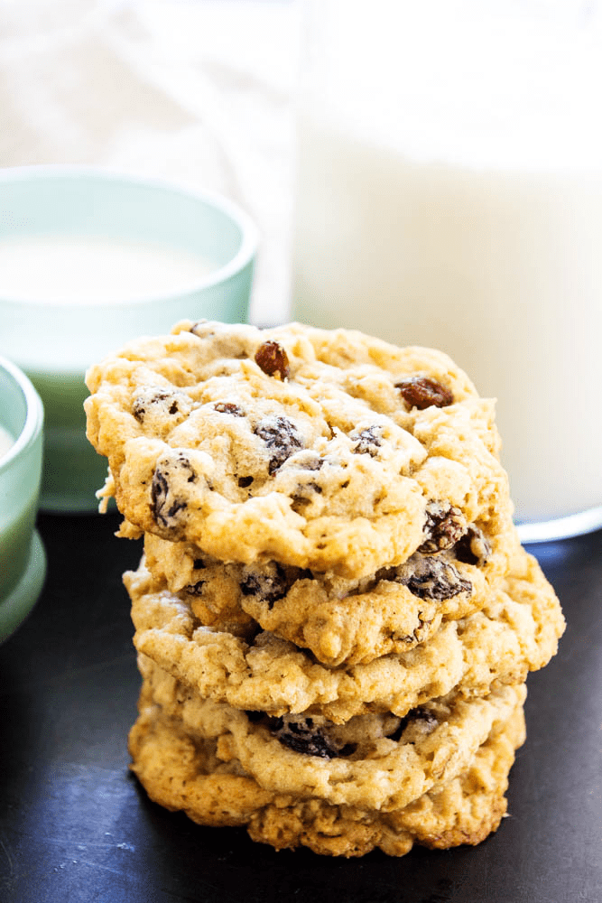 stack of 5 Oatmeal Raisin Cookies with a glass of milk