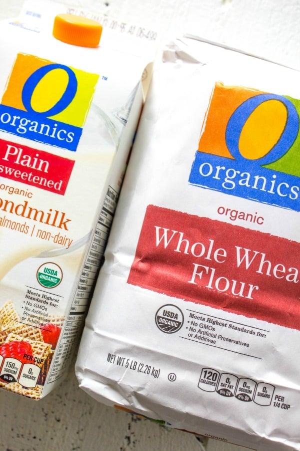 cardboard carton of almond milk, bag of whole wheat flour