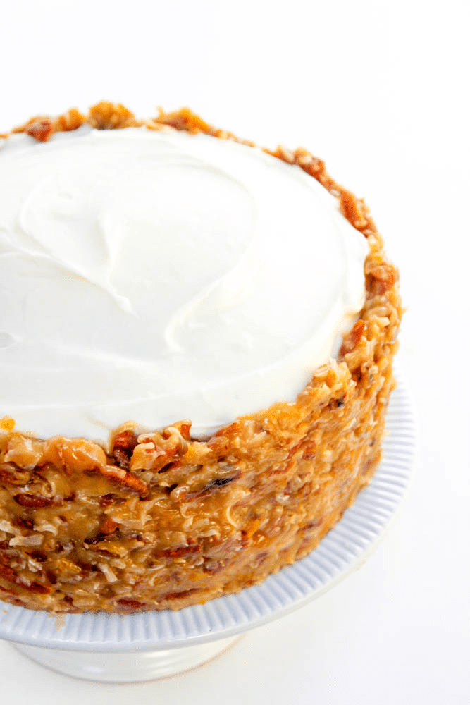 GERMAN CHOCOLATE CARROT CAKE - Layers of carrot cake and cream cheese frosting; slathered in German chocolate frosting making it the best carrot cake ever.