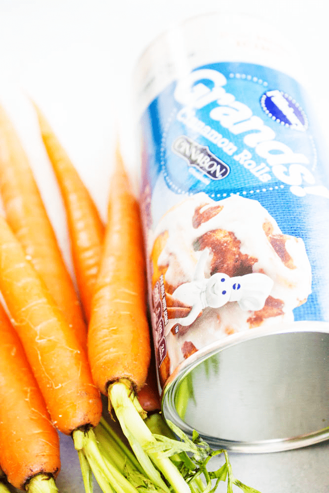 photo of carrots and a can of pillsbury cinnamon rolls