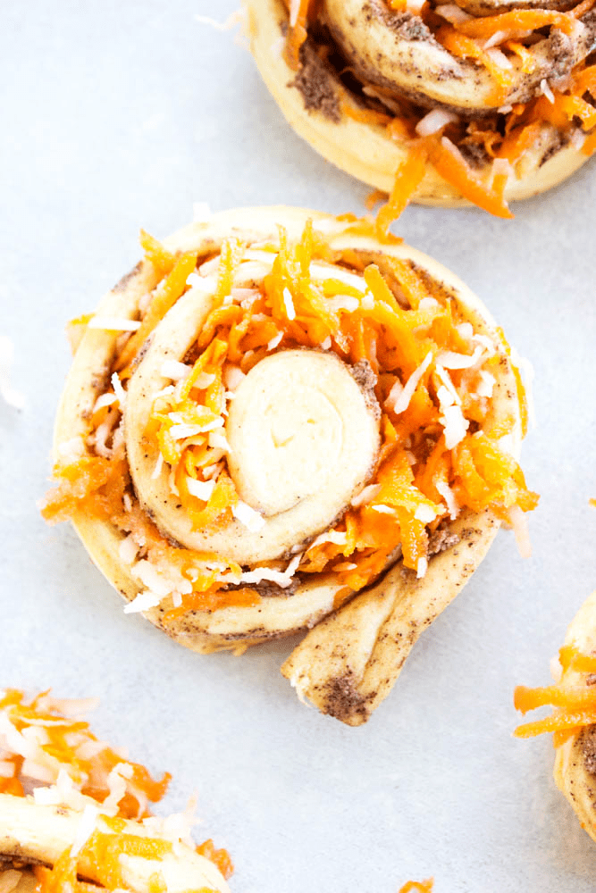 photo of cinnamon roll dough rolled with shredded carrot filling
