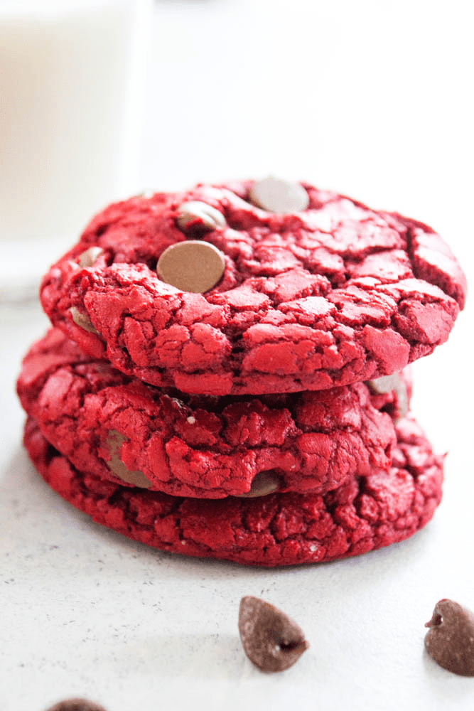 stack of 3 red velvet cookies with chocolate chips